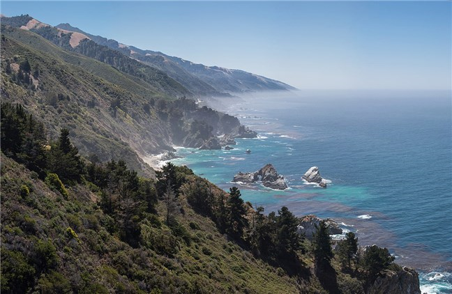 The latest Mac OS version is called Big Sur, like this Californian coastline
