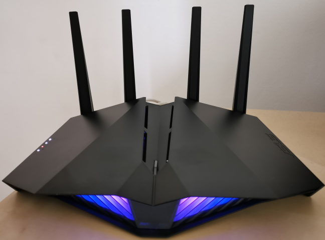 The RGB lighting on the front of the ASUS RT-AX82U
