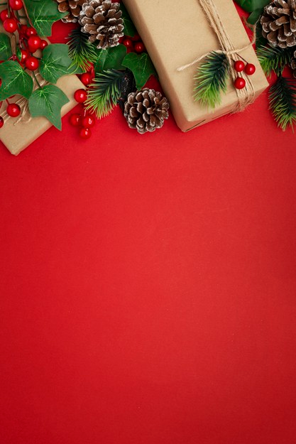 Christmas presents and decorations on top of a red background
