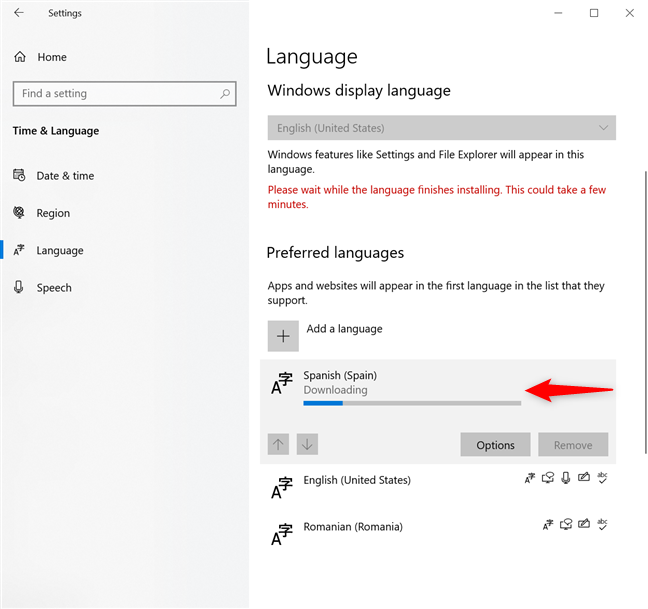 Wait for the Windows 10 language pack download to finish
