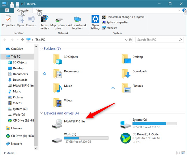 The smartphone is shown as a device in File Explorer