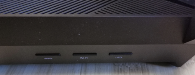 The buttons on the side of the TP-Link Archer AX6000