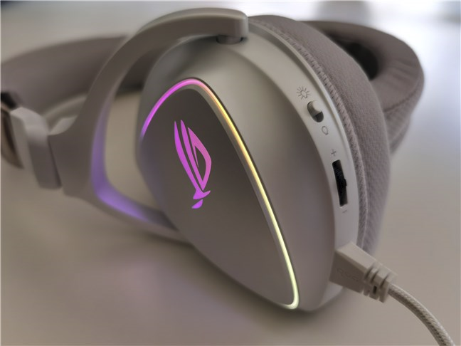 Controls are located on the left ear cup of the ASUS ROG Delta