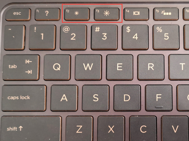 The keys designed to adjust brightness on an HP keyboard