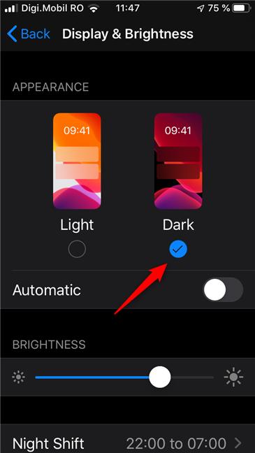 Choosing Dark activates the Dark Mode on your iPhone