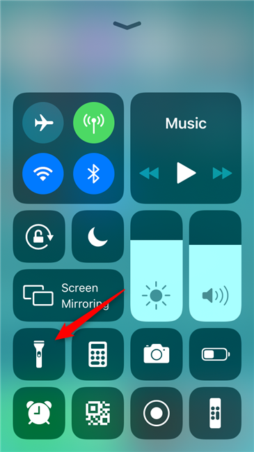 The flashlight button from the iPhone Control Center