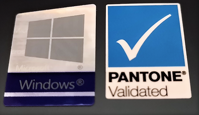 The Pantone Validated sticker on the back of a laptop