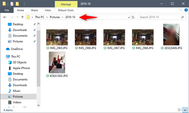 The imported photos and videos are stored in a separate folder from your Pictures folder