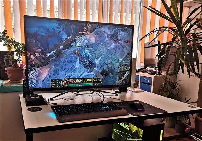 Playing a game on the ASUS ROG Swift PG43U