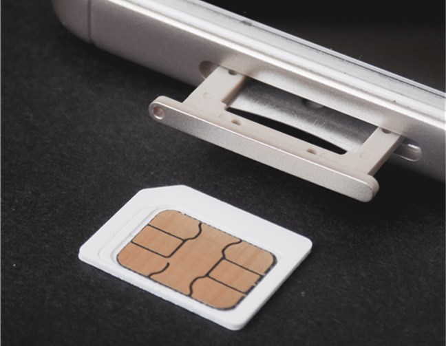 A SIM card and the SIM card tray of a phone