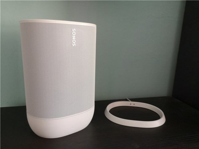 A Sonos Move speaker taken out of its charging cradle