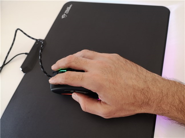 Holding the Trust GXT 900 Kudos gaming mouse