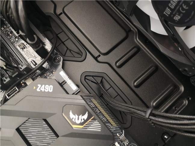 The ASUS TUF Gaming GT301 computer case has rubber grommets