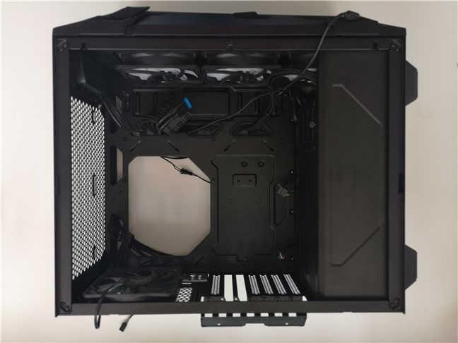 The ASUS TUF Gaming GT301 computer case with the power supply mounted