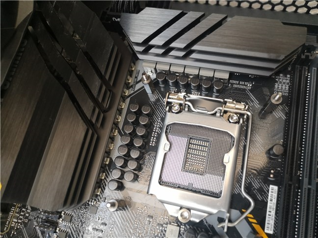 The large VRMs and heatsinks around the CPU socket