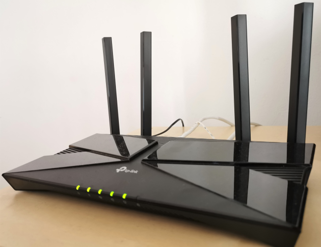 The LEDs on the front of the TP-Link Archer AX10