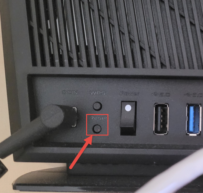 Use the Reset button on the back of your ASUS router